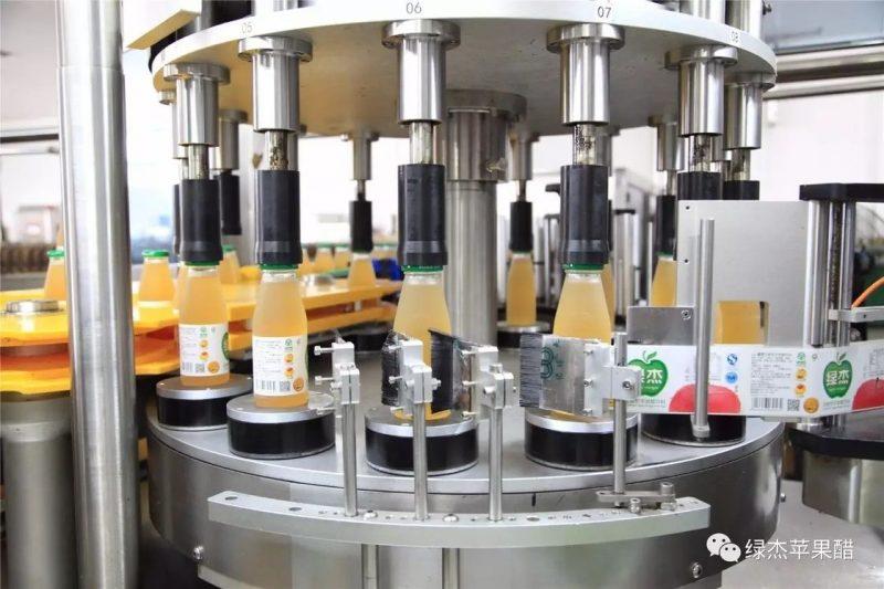 الصين جولة زجاجة الروتاري Labeler مع دوران صحن آلة وسم نظام المورد
